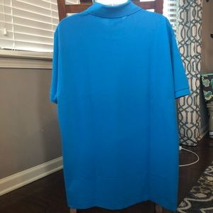 Lacoste Shirts - NWT blue Lacoste polo